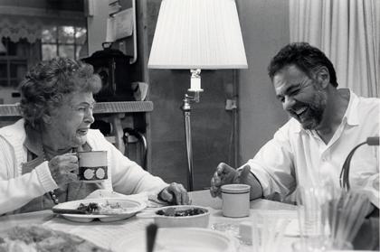 smiling old lady with tea mug